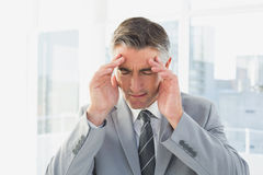 Businessman suffering from a headache Royalty Free Stock Photo