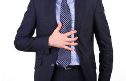 Businessman suffering from heartburn. Royalty Free Stock Image