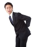 Businessman suffering from low back pain. This is a photograph of a businessman suffering from low back pain Royalty Free Stock Photos