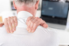 Businessman suffering from neck pain Stock Photos