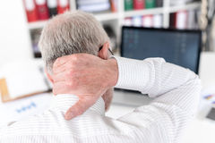 Businessman suffering from neck pain Stock Photography