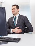 Businessman suffering from pain Stock Images