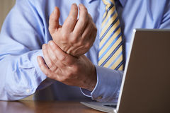 Businessman Suffering From Repetitive Strain Injury (RSI) stock photography