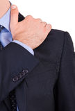 Businessman suffering from shoulder pain. stock photography