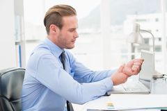 Businessman suffering from wrist pain Stock Photos