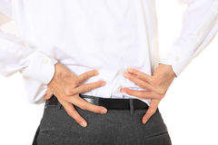 Businessman suffers from back pain Royalty Free Stock Photos