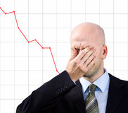 Businessman suffers from a headache. Problems in business royalty free stock image
