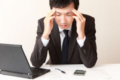Businessman suffers from headache or Asthenopia Royalty Free Stock Images