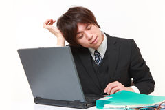 Businessman suffers from headache Royalty Free Stock Images
