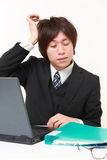 Businessman suffers from headache Royalty Free Stock Photography