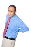Businessman suffers from lower back pain. Due to stress at work Stock Photography
