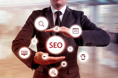 Businessman suggested effective 'SEO' optimisation approach. Hands presenting a 'SEO' flowchart Stock Image