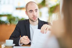 Business contract. Businessman suggesting to his partner to sign a contract Royalty Free Stock Photography