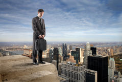 Businessman suicide. Standing on the top of building Royalty Free Stock Photos