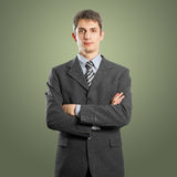 Businessman In Suit. Man businessman in suit, with folded hands, looking on camera Royalty Free Stock Images