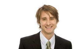 Businessman in suit. Businessman in a black suit and a green tie smiles Stock Photography