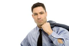 Businessman in suit. Businessman in a suit stands holding a jacket Royalty Free Stock Images