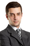 Businessman In Suit. Man businessman in suit, looking on camera, with folded hands Stock Photos