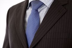Businessman Suit. This is a close up of businessman wearing a tie, shirt, and suit Stock Images