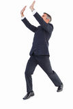 Businessman in suit with arms up Stock Image