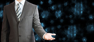 Businessman in a suit. Blue glowing figures Stock Photography