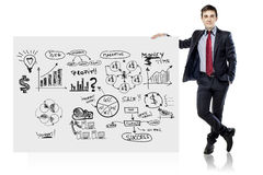 Businessman in suit and business plan Royalty Free Stock Photography
