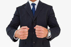Businessman in suit clenching fists. On white background Stock Images