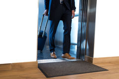 Businessman in suit comes out from elevator Royalty Free Stock Photo