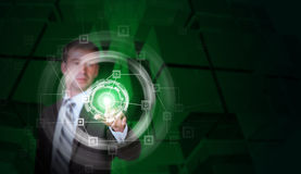 Businessman in suit finger presses virtual button Royalty Free Stock Photo