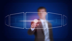 Businessman in suit finger presses virtual button Stock Images