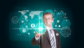 Businessman in suit finger presses virtual button Royalty Free Stock Photography