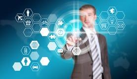 Businessman in suit finger presses virtual button Stock Photos