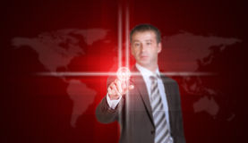 Businessman in suit finger presses virtual button Stock Photography