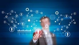Businessman in suit finger presses virtual button Stock Image