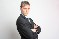Businessman in suit with folded arms Royalty Free Stock Photography