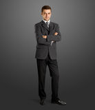 Businessman In Suit Full Length. Business man in suit full-length, looking on camera, with folded hands Royalty Free Stock Photos