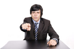 Businessman in a suit gestures with his finger Stock Images