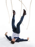 Businessman in suit got out of manipulating ropes. Isolated on white Royalty Free Stock Photography