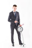 Businessman in a suit and a grandfather clock Royalty Free Stock Images