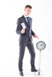 Businessman in a suit and a grandfather clock Royalty Free Stock Photo