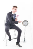 Businessman in a suit and a grandfather clock Stock Image