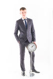 Businessman in a suit and a grandfather clock Stock Photography