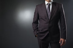 Businessman in suit on gray background Stock Photos
