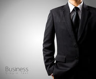 Businessman in suit on gray background. With simple text Royalty Free Stock Images