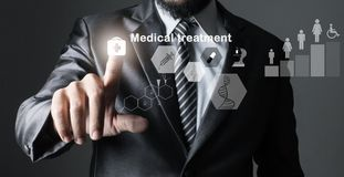 Businessman in suit grey of hand touching, inspecting medicine. stock photography