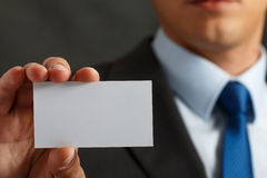 Businessman in suit and hand holding blank calling card Royalty Free Stock Image