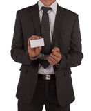 Businessman in suit and handcuffs showing card. Businessman in suit and handcuffs showing a blank business card isolated on white Stock Image