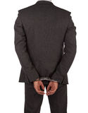 Businessman in suit and handcuffs Stock Photography