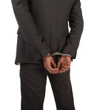 Businessman in suit and handcuffs Stock Photos