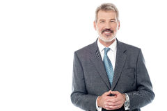Businessman in suit with hands clasped Royalty Free Stock Photography